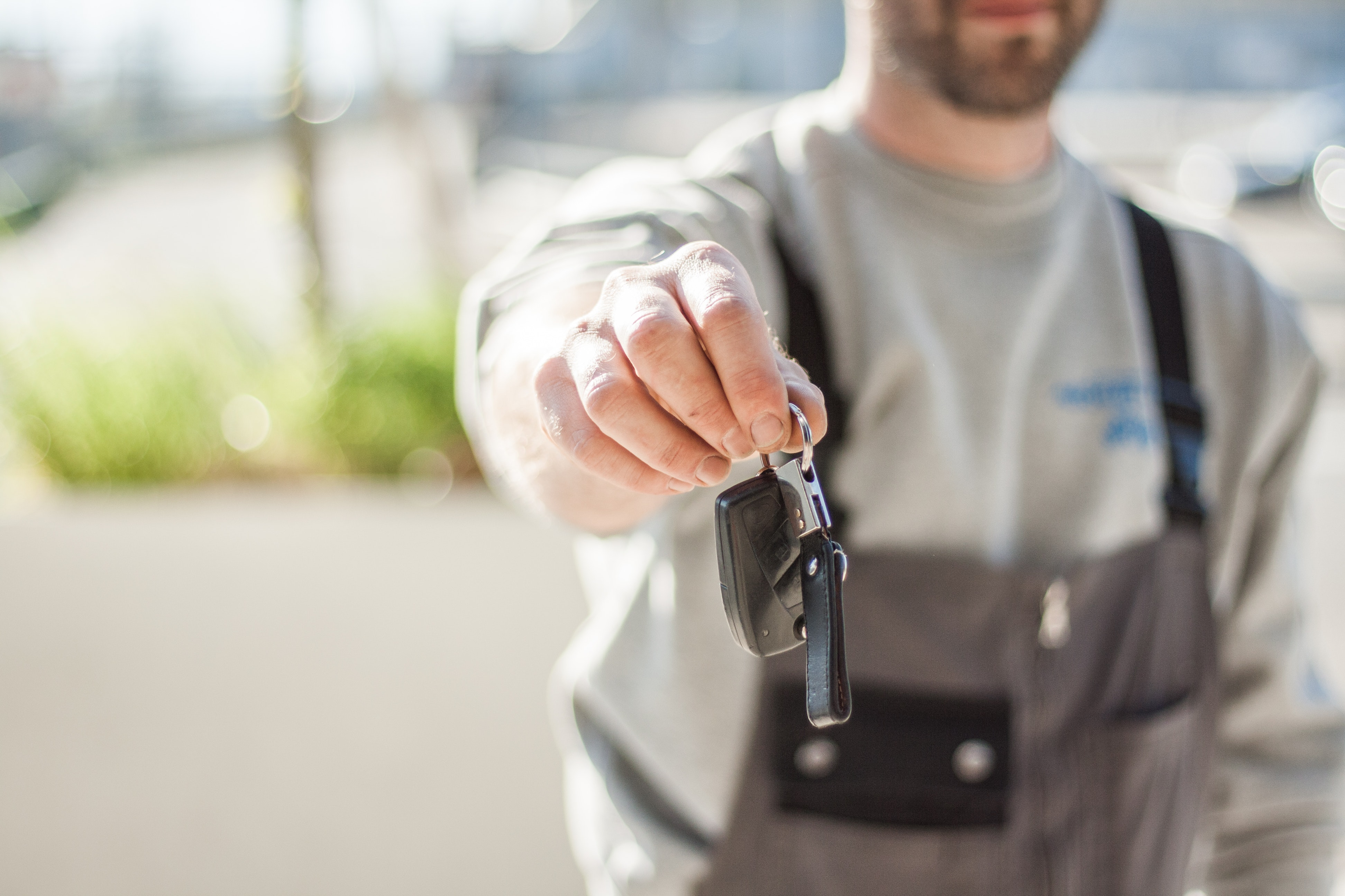 person holding car keys